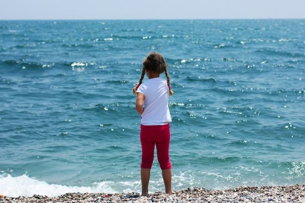 Little girl playing on the beach in antalya