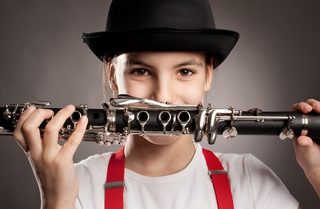Little girl playing clarinet