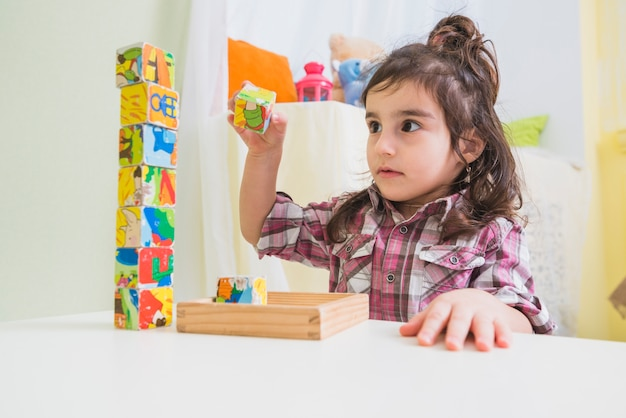 Little girl playing cubes