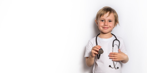 Little girl playing doctor with stethoscope