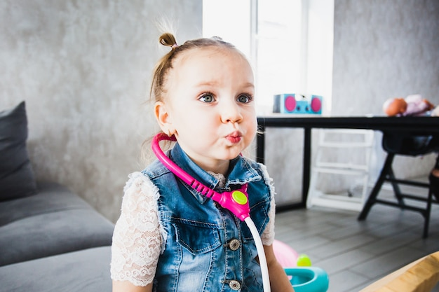 Little girl playing at home, watching tv, cartoons,