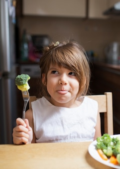 Little girl playing with healthy food