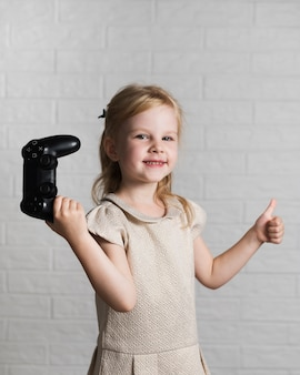 Little girl playing with joystick at home