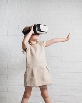 Little girl playing with virtual reality headset