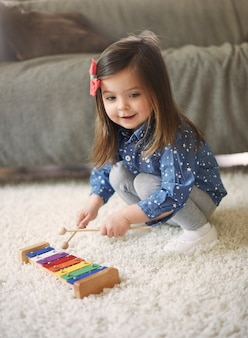 Little girl playing the xylophone