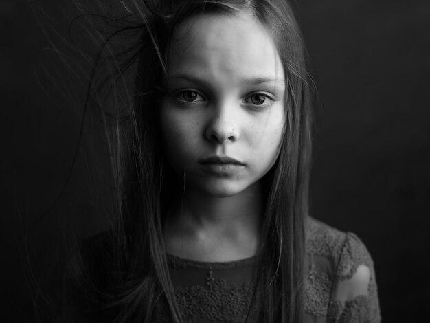 Little girl posing long hair closeup black and white photo