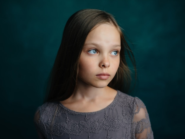 Little girl posing long hair glamor studio