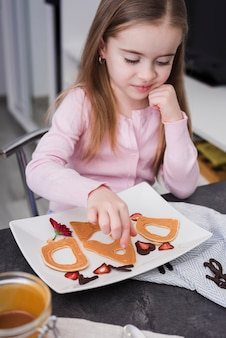 Little girl preparing breakfast on father's day