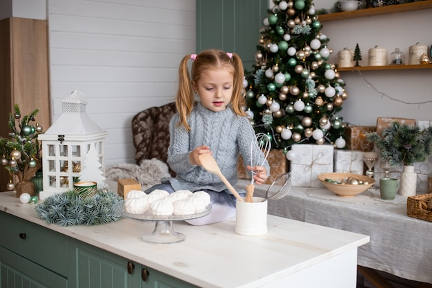 Little girl preparing christmas food at home