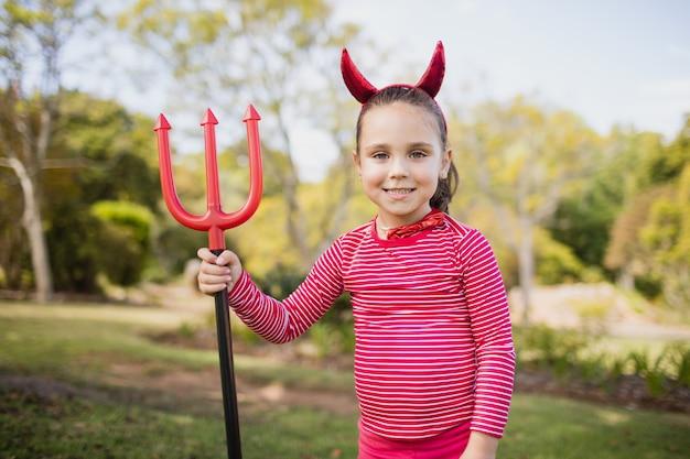 Little girl pretending to be a devil