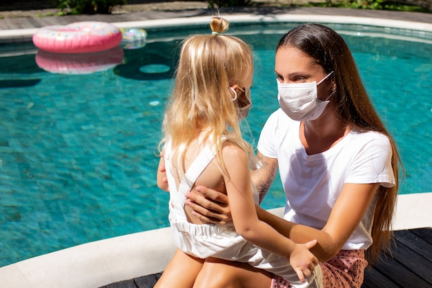 Little girl puts on a mask for mom.  high quality photo
