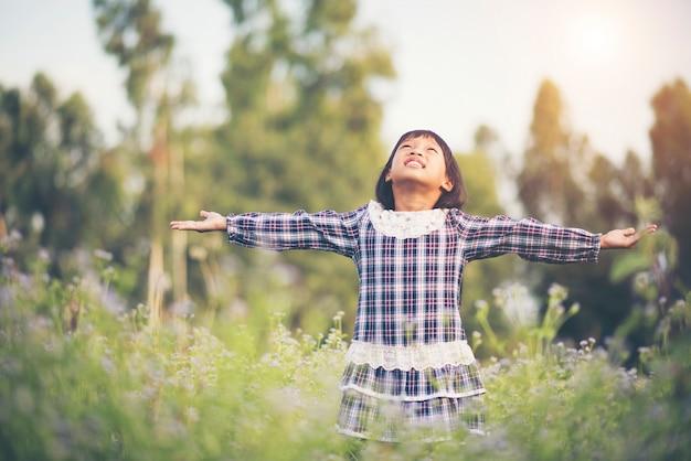 Little girl raising hand refresh in the air