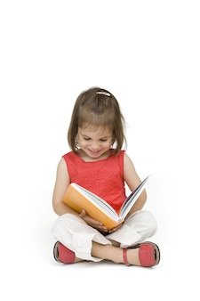 Little girl reading a book isolated