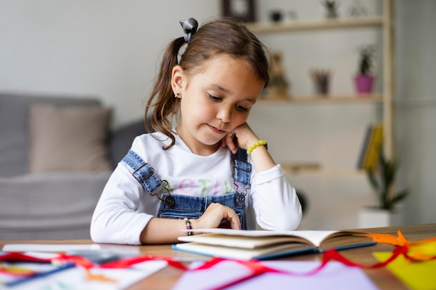 Little girl reading from a book