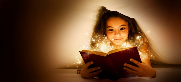Little girl reading from a magic book