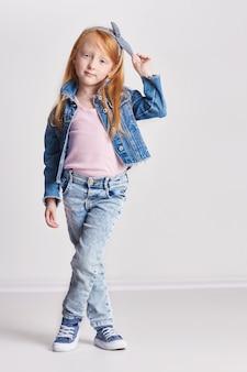 Little girl red hair beautiful long hair.