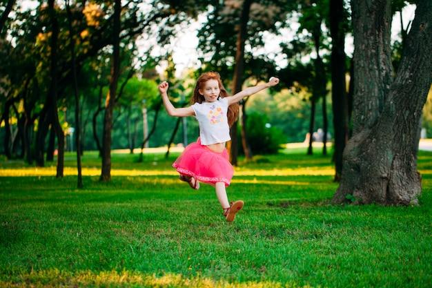 Little girl running in the park