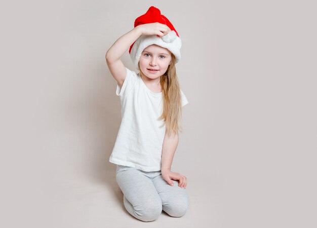 Little girl in santa claus hat
