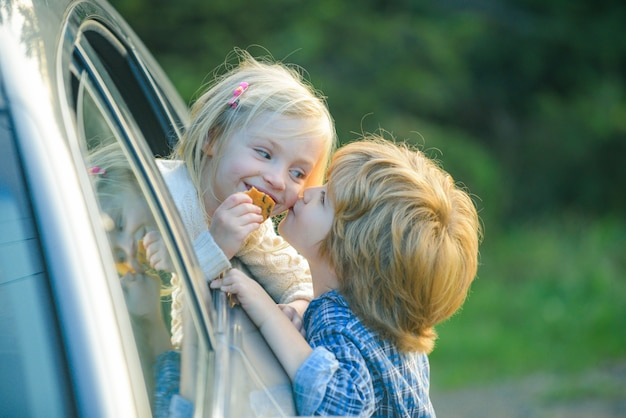 Little girl says goodbye to little boyfriend who sails for long time farewell child concept little b...