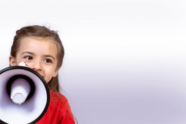 Little girl screaming on a megaphone.