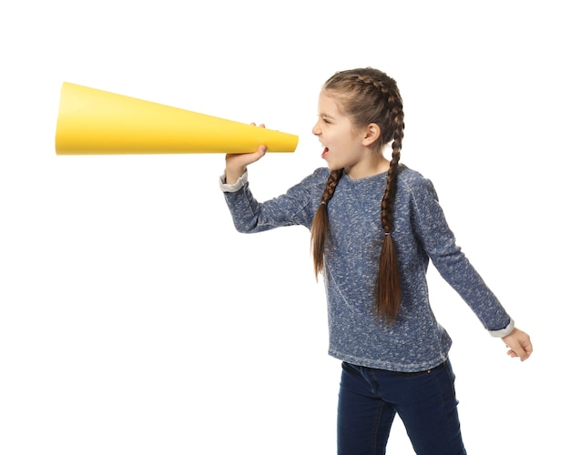 Little girl shouting into paper megaphone on white