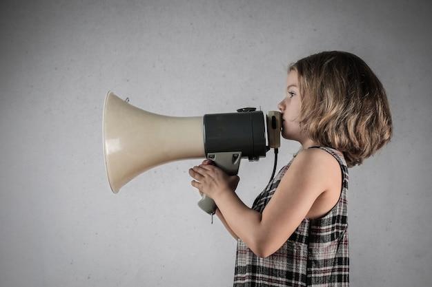 Little girl shouting a message
