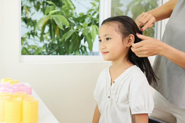 Little girl sitting at hair salon