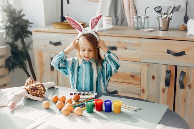 Little girl sitting in a kitchen