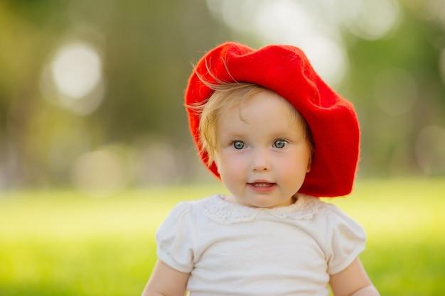 Little girl smiling on the green grass