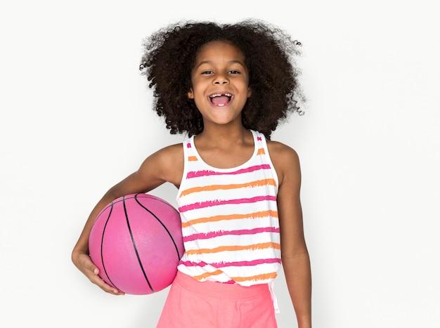 Little girl smiling happiness basketball sport portrait