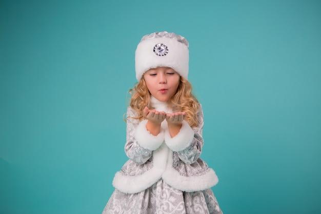 Little girl smiling in snow maiden costume