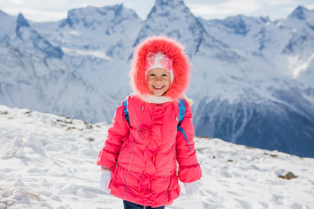 Little girl smiling in winter clothes