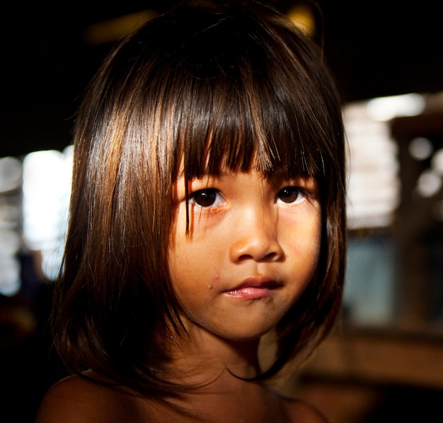 Little girl staring at the camera.