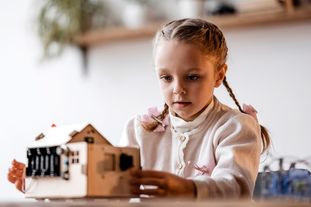 Little girl studying an electrical device