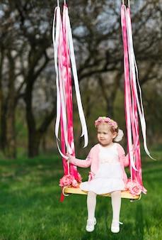 Little girl on the swing, little girl at park, cute little girl, little girl