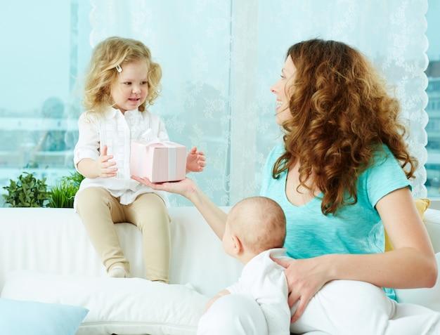 Little girl taking a present