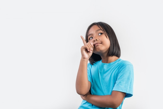 Little girl thinking in studio shot