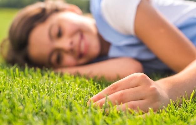 Little girl touching the grass