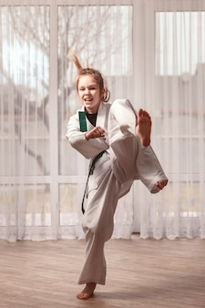 Little girl trains karate at home