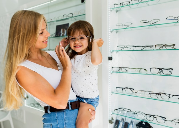 Little girl trying on glasses frame