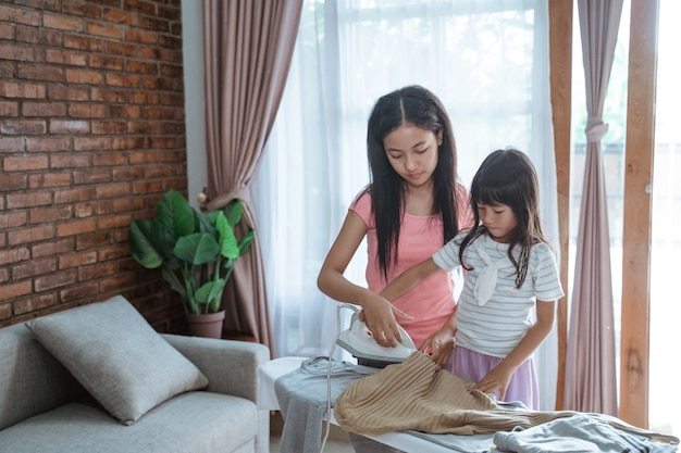 Little girl trys to help with household chores