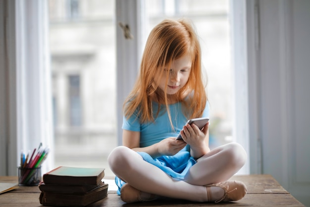 Little girl using a smartphone