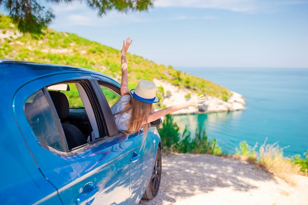 Little girl on vacation travel by car