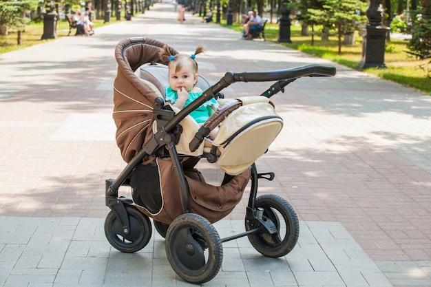 Little girl on a walk in a stroller