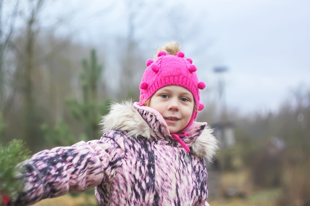 Little girl walks outdoors in autumn day in countryside. emotional portrait.