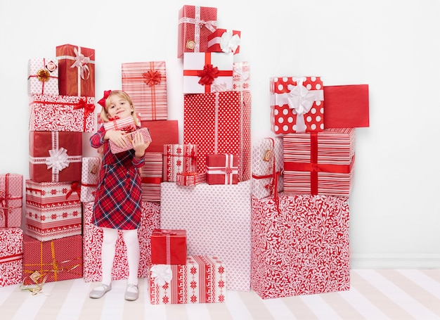 Little girl and wall of presents