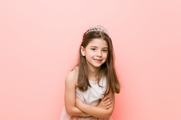 Little girl wearing a princess look laughing and having fun.