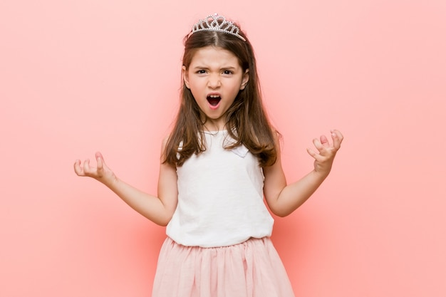 Little girl wearing a princess look screaming with rage.