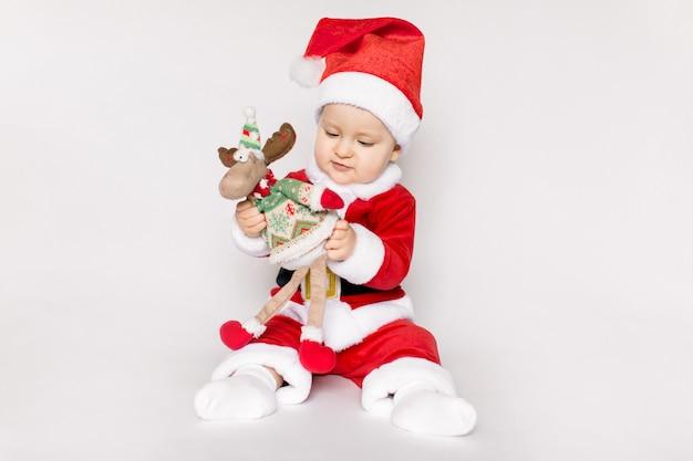 Little girl wearing santa claus costume