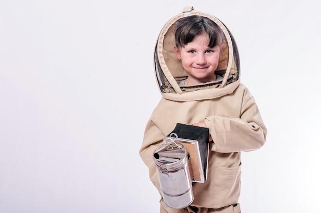 A little girl wears in bee suit in studio white background.